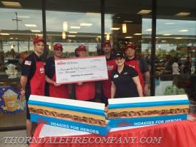 Wawa presented each team with a check for $1,000.